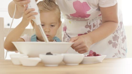 Thumbnail for Serious Pretty Little Girl Concentrating On Baking
