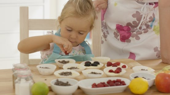 Thumbnail for Little Girl Placing Berries On Muffins