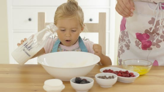 Thumbnail for Cute Baby Baking With Woman In a Kitchen
