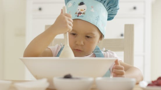 Thumbnail for Adorable Serious Toddler At Mixing Bowl