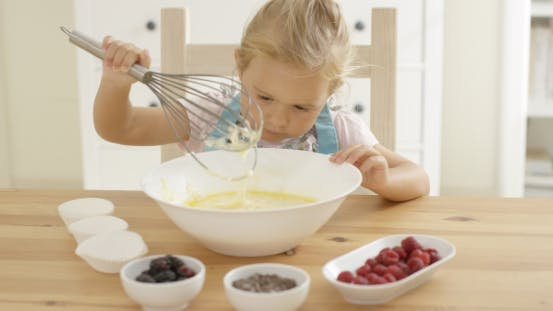 Thumbnail for Girl Looking At Muffin Batter With Whisk