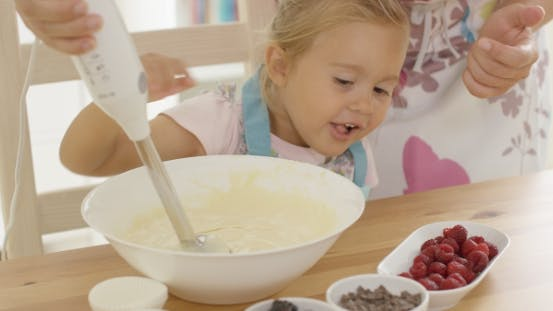 Thumbnail for Cute Happy Little Girl Helping With The Baking