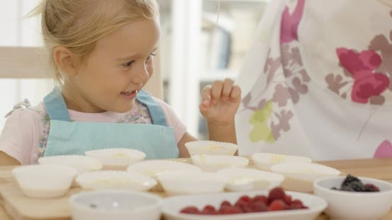 Thumbnail for Happy Little Girl With Empty Muffin Holders