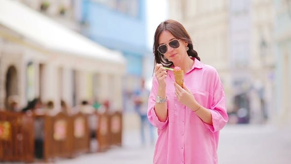 Thumbnail for Young Girl Eating Ice Cream Cone Outdoors. Summer Concept - Woman With Sweet Ice-cream At Hot Day