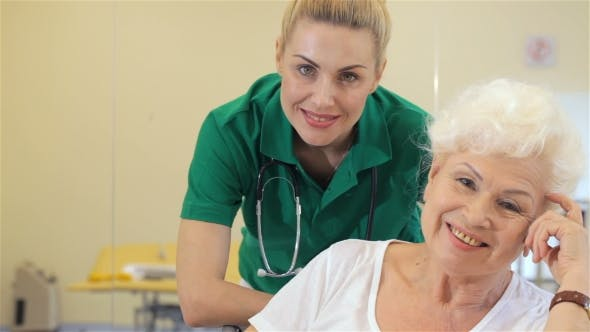 Cover Image for Nurse Smiles For Female Patient
