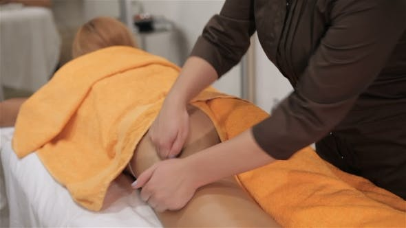 Thumbnail for Masseur Massages Client's Thigh At The Cosmetology Centre