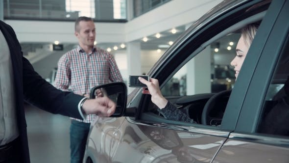 Thumbnail for Sales Manager Gives The Client The Keys From The Car