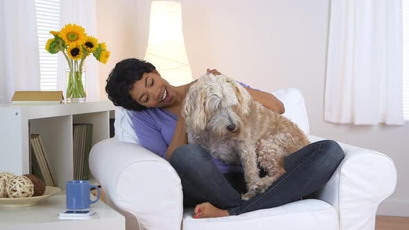 Thumbnail for Black woman smiling and petting dog