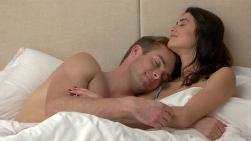 Couple Is Lying in Bed.