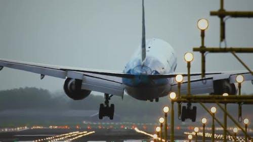 Passenger airplane landing towards the runway