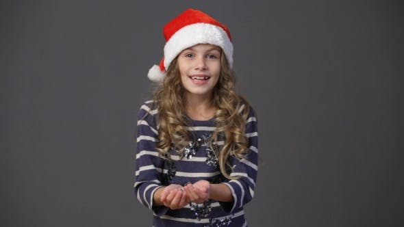 Thumbnail for Little Girl In a Christmas Cap Throwing Up Confetti