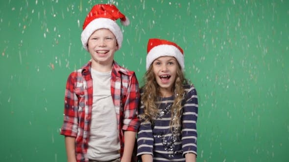 Cover Image for Children In Christmas Caps Throwing Up Confetti
