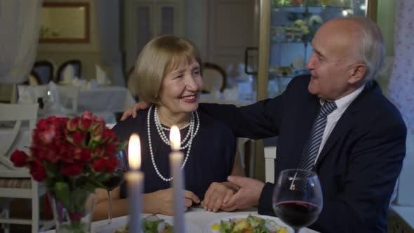 Cover Image for Elderly Couple Drinking Wine in Restaurant