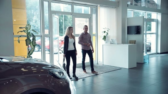 Thumbnail for Couple Entering In Car Dealership To Chose Car