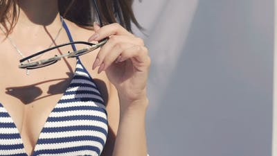 Seductive Girl Posing In Swimwear With Sunglasses.