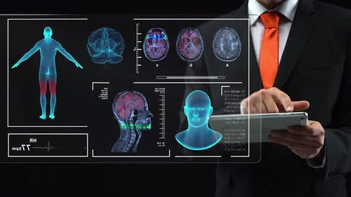 Doctor Looking Futuristic Tablet and Working at Technological Medical Digital Holographic Monitor