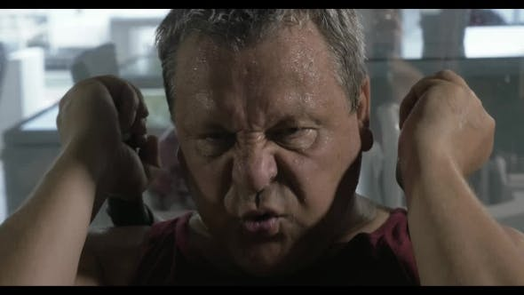 Thumbnail for Senior Man Training Hard In The Gym He Has a Heavy Breathing And Sweat All Over The Body