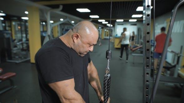 Thumbnail for Muscular Man Lifting Weights