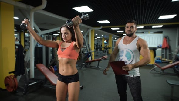 Thumbnail for Fitness Instructor And Client At The Gym.
