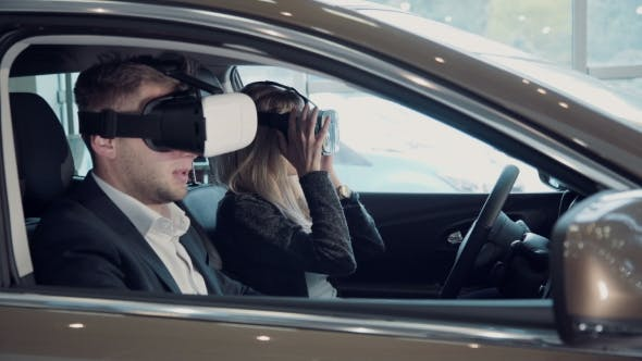 Thumbnail for Young Woman Going For a Test Drive In a New Car Using VR