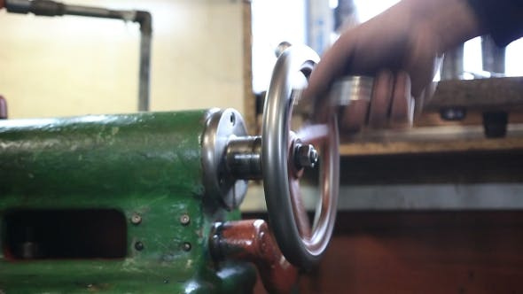 Thumbnail for Man Hand Operating Old Controls Of Turning Machine