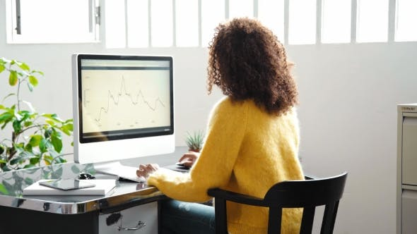Thumbnail for Attractive Black Woman Works On Computer In Office