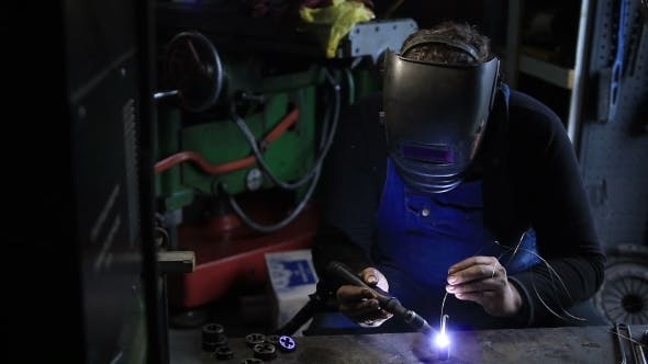 Cover Image for Welder Man Tig Welding In Workshop.