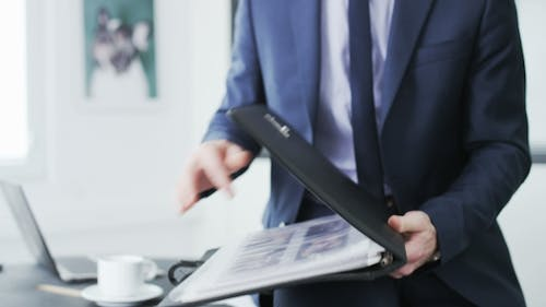 Businessman checking a file of documents