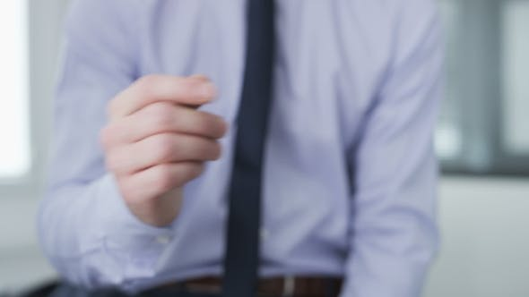 Thumbnail for Businessman making gestures with his hands
