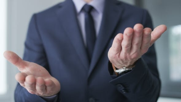 Thumbnail for Businessman making the okay gesture with his hands