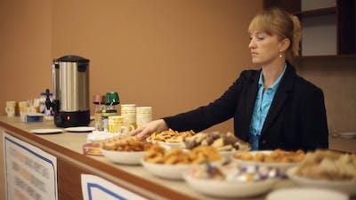 Girl Secretary Prepares Bar for a Coffee Break