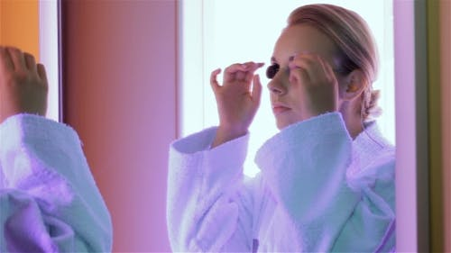 Woman Prepares For The Tanning At The Tanning Booth