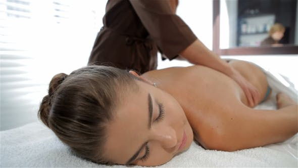 Thumbnail for Massage Specialist Begins To Massage Female Client