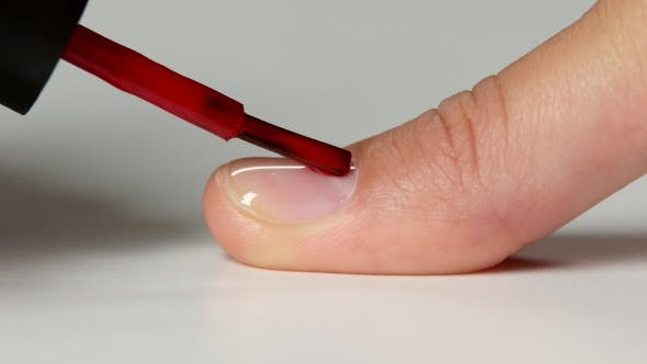 Thumbnail for Manicurist Doing a Coating Of a Red Nail Varnish To Customer.