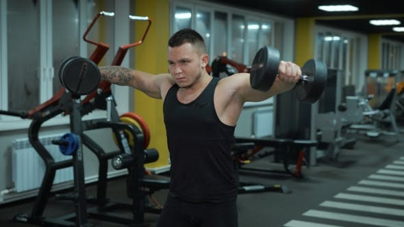 Thumbnail for Young Man Does Exercise With Dumbbells