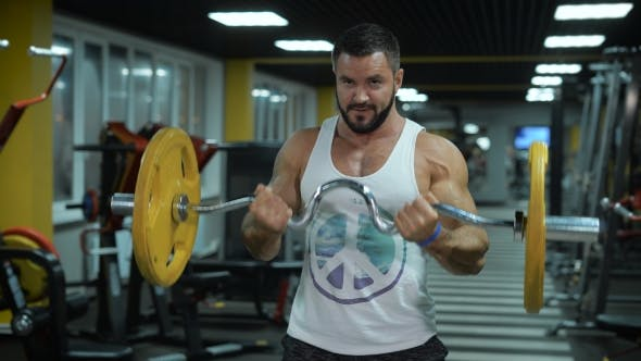 Thumbnail for Round View Of Muscular Man With Barbell At The Gym