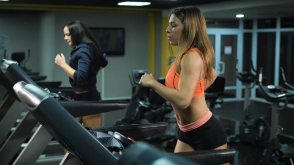 Thumbnail for Two Fit Girls Running At The Gym