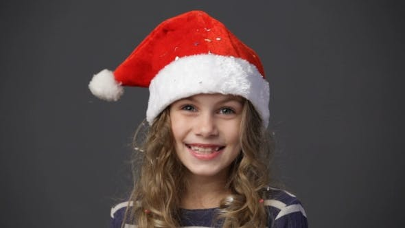 Cover Image for Cute Little Girl In Xmas Cap Smiling