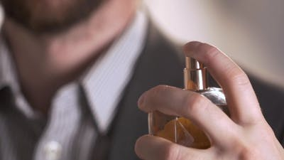 Of Handsome Young Business Man Using Perfume