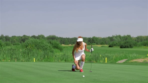 Thumbnail for Woman Stands On Her Knee At The Golf