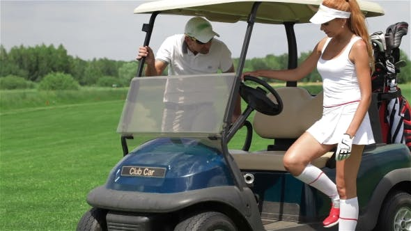 Thumbnail for Man And Woman Sit In Golf Cart