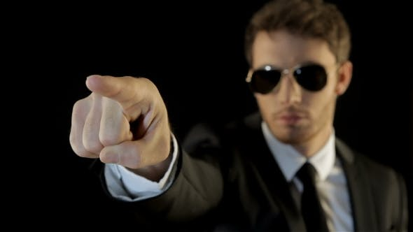Thumbnail for Man Dressed Like Security Points His Forefinger