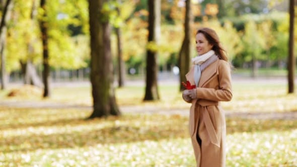Thumbnail for Beautiful Young Woman Walking In Autumn Park 2