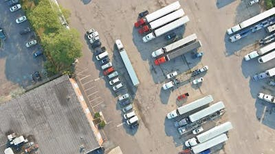 Aerial View of Parking Lot with Trucks on Transportation of Truck Rest Area Dock