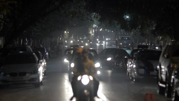 Thumbnail for Motorbikes And Cars In Night Hanoi Vietnam