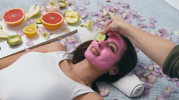 Cover Image for Young Woman With Pink Mask Relaxing in Wellness Center