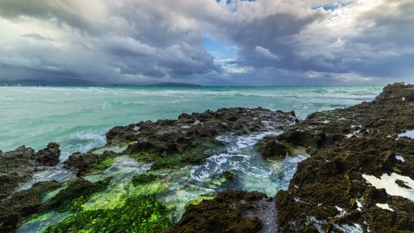 Thumbnail for Beautiful Sea View, Wave Hitting The Rock Covered By Vibrant Green Mossy And Algae Dramatic Cloudy