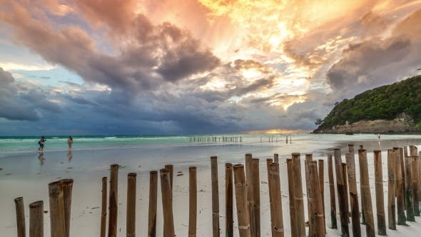 Cover Image for Sunset On a Background Of Fence Made Of Bamboo From The Waves On The Beach Of Boracay Island