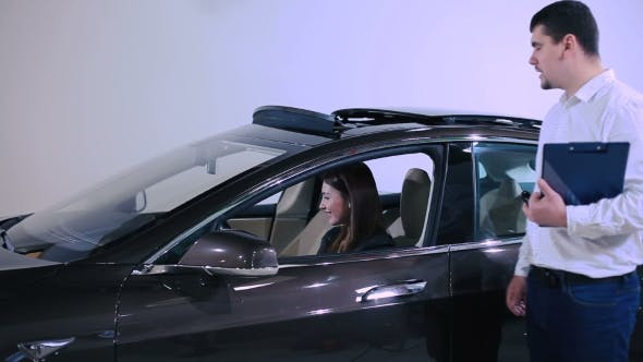 Thumbnail for The Girl Sitting Inside The Electric Car