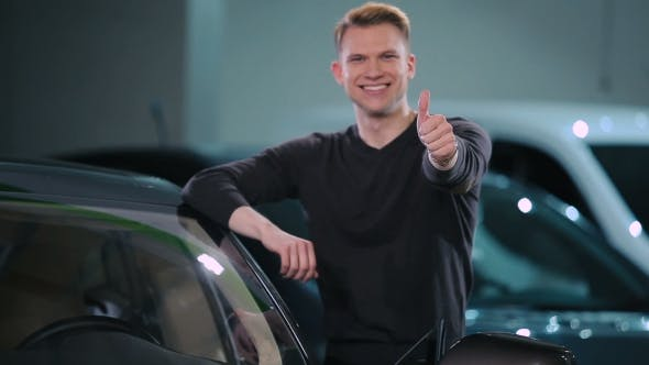 Thumbnail for Young Man Buy a Electric Car
